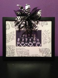 Dance/Cheer Gift for Senior Night: Take a team photo in black and white, have the younger dancers/cheerleaders write a note to the senior on a photo mat, and finish by hot-gluing a ribbon in your school colors.