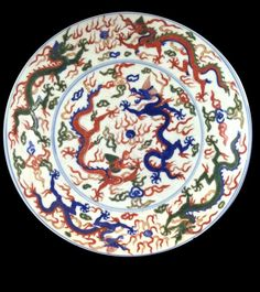 "Ming Period Chinese Famille Rose Imperial Dragon, Decorated in bright famille Rose painting of Six Imperial Dragons chasing the flaming Pearls surrounding the circumference. Mark on Base, 6 Characters, JiaJing Reign and possibly of the Period. Measure: 11 1/8"" Diameter. 2"" Height"