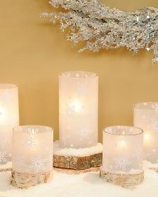 DIY Snowflake Hurricane Candleholder - Make affordable snowflake hurricane wraps using little more than wax paper and repurposed grocery bags.