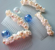 Beach wedding seashell hair combs. Nautical shell hair accessories for the beach bride or her bridesmaids add a touch of elegance and class to