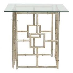 """Showcasing a bamboo-inspired base and silver finish, this glass-topped side table brings contemporary appeal to your living room or home library.     Product: End tableConstruction Material: Iron and glassColor: Silver and clear Features: Bamboo-inspired base Dimensions: 21.7"""" H x 21.7"""" W x 21.4"""" DAssembly: Assembly required"""