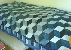 """Check out this amazing quilt. While the creation plays with idea of re-purposing old accumulated jeans of different shades, it is definitely a charm to observe its genuineness in managing a 3D illusion! The optical illusion quilt in denim is titled """"Philip's Patchwork Jeans"""". It is said to be a patchwork made of old jeans …"""
