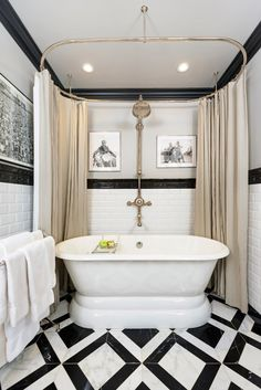 Tile Floor and Monochrome Luxury Bathroom Idea | Bathroom design idea: tile Floor and Monochrome Style and a gorgeous traditional claw foot porcelain tubs. After all, all luxury new construction homes should be built with at least one freestanding tub in the place. ➤To see more Luxury Bathroom ideas visit us at www.luxurybathrooms.eu #luxurybathrooms #homedecorideas #bathroomideas @BathroomsLuxury