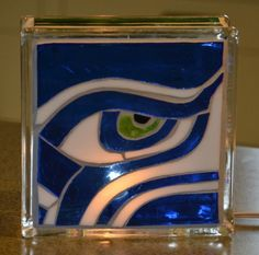 Its almost football season and this piece is a great way to show your 12th man support for our beloved Seahawks!    Strips of green and blue
