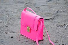 Neon-pink bag.