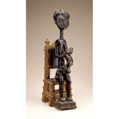 Queen Mother and Child. Asante, Ghana, Late 19th-early 20th century.  Wood, pigment, glass, beads, fiber.