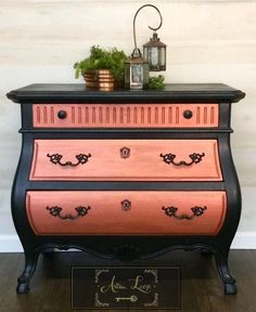 Bombay chest of drawers painted in black. Copper guilding wax accentuates the front of each each three drawers that displays a fleur de lis when pulled to open.