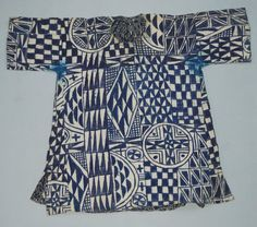 Tunic  made of white cotton printed with blue geometric designs; round neck opening; slit at both bottom corners. Made in Nigeria. Acquired in Cameroon Length: 88 centimetres Width: 108 centimetres