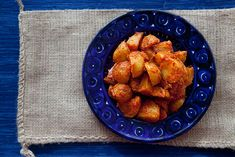 A classic Spanish tapas appetizer known as patatas bravas, or angry potatoes - roasted potatoes tossed with a spicy, smoky tomato sauce.