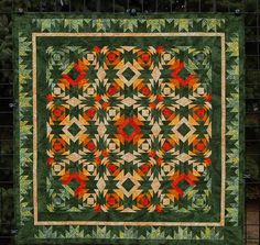 This dynamic quilt if full of energy and color to excite anyone sees it. The colors suit the traditional Pineapple blocks and give it a warm