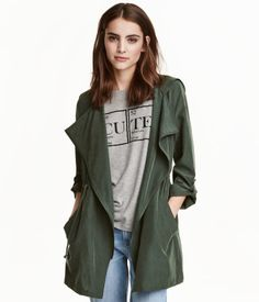 Dark green. Parka in a modal blend with a soft, brushed finish. Hood, diagonal zip at front, and side pockets.…