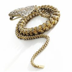 Gold and diamond serpent necklace, mid-19th century Designed as a long, articulated serpent, its open jaws clasping the end of its tail, decorated in the center of the head with an old-mine cushion-shaped diamond weighing approximately 4.00 carats, bordered by clusters of smaller old-mine and single-cut diamonds,  the tapering body decorated with circular motifs pavé-set with diamonds as well as with collet-set old-mine diamonds, length 32 inches; together with an additional link.