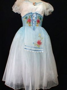 One the most delicate peasant style Romantic tutu of our Collection. It can be used for the ballet Napoli, Giselle, Coppelia, la Fille Mal Gardee, La Vivandiere and many other peasant variations. This tutu can be made in pale blue or in pale pink. Both colors feature the amazing ombre color, fading from blue (or pink) to white. The bodice is made following the peasant style, with a white undershirt, short organza puffy white sleeves, and a lover bodice in blue (or pink) with a laced pattern…