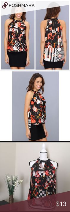 Kenneth Cole Camilla Blouse New with tag. Beautiful silk like fabric. Light weight, hi-low style top. Update your casual look in the Kenneth Cole New York Camila Blouse featuring cutout details, floral print, draped details, halter neck, sleeveless, hole details. Blouse flaunts a vibrant abstract floral print throughout. This Kenneth Cole New York Camila Blouse will make a perfect new addition to your casualwear portfolio. Kenneth Cole Tops Blouses