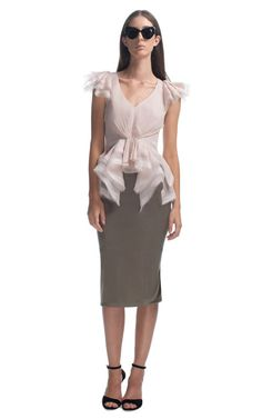 This delicate, v-neck top features lightweight, double layer organza flutter sleeves and ruffle detail at the trapeze hemline   Back center zip with hook and eye closure   100% silk