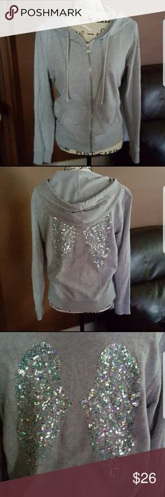 Victoria's Secret Bling Hoddie In great pre owned condition. Victoria's Secret Bling 'Angel Wing' zip up hoodie. Sequence are iridescent and none are missing. Size medium, runs slightly large. I wore this only a few times because it was slightly larger than I like. I also washed inside out and line dried every time.   Additional questions please ask. HAPPY POSHING! PINK Victoria's Secret Tops Sweatshirts & Hoodies