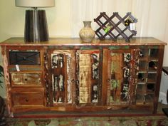 """Reclaimed wood, wine buffet in a distressed array of colors. Made of solid sheeshum wood, this piece has storage space for 10 bottles down the right side and three drawers down the left side. 76""""long x 18""""deep x 36""""high. Arrived: Monday September 19th, 2016"""