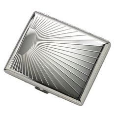 "This beautifully designed cigarette case is factory embossed with a sun ray design on the front and back, and has an area for engraving initials or a name on the front. When closed, the case measures 3 1/2"" x 4"" x 5/8"". The inside has springy bars to hold the cigarettes in place. It holds 20 regular size or 100s size cigarettes - ten on each side. Comes packaged in a white gift box. Engraving fee is included in the purchase price."