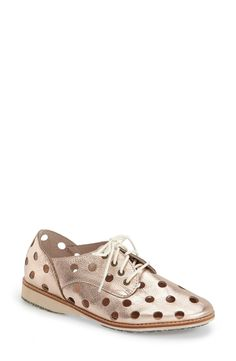 Laser-cut circles lend a fun and sophisticated update to this classic oxford in a pretty rose gold hue.