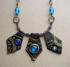 Three pendant necklace made with polymer clay and blue stones, by RoyalKitness on Etsy.