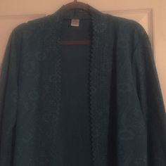 Elegant, lightweight, subtle turquoise cardigan. Scalloped trim on neckline, front, and sleeves. Perfect for work or with jeans. Either way, you're sure to always be in style. NWOT Jackets & Coats Blazers