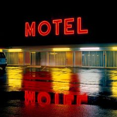 Motel neon at night, photo by Jeff Brouws