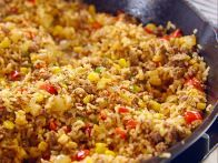 While the cowboys work, Ree Drummond is making homemade takeout for lunch, with Tex-Mex Fried Rice and Cowboy Chopped Salad. For dinner, it's Smothered Pork Chops with Smashed Red Potatoes and Sliced Tomatoes, a favorite fast supper. Rice Recipes, Pasta Recipes, Mexican Food Recipes, Cooking Recipes, Ethnic Recipes, Mexican Dishes, Skillet Recipes, Skillet Meals, Rice