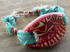 Mixed Media Rustic Boho Gypsy Pink Orange and Turquoise Polymer Clay Tribal Doodle Focal Bead Bracelet with Sari Silk Ribbon by SpontaneousSoul on Etsy https://www.etsy.com/listing/221733380/mixed-media-rustic-boho-gypsy-pink
