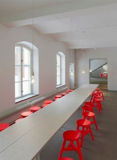 long table and red stools