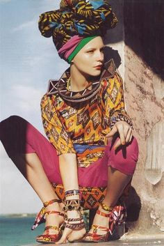 African inspired fabrics and colors- i like this photo because not only is it modern African fashion clothes, however i'm not a racism person but i like it that a white person/ model is wearing African clothes  and its a nice change. i never seen a white person dress like that.
