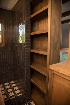 slidind door / storage space!!!! great deal for a small space...and the tiles? just beautiful!