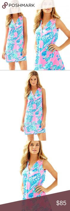 Lilly Pultizer Essie Dress Pink Pout Blue Dress Brand new with tags, size XS. This Lilly Pultizer Essie Dress Pink Pout Barefoot Princess Dress is stunning! Love the vibrant color and pattern on this! The mix of pink, blue, green and white is so iconic Lilly Pultizer. The seashell pattern is so beautiful! This sleeveless dress has gold button detailing at the neckline and smocking around the neckline. Made of 60% Cotton and 40% Modal. A sold out print, your chance to own it here! Lilly…
