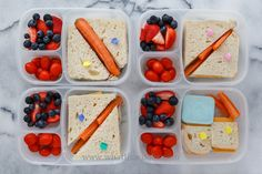 Simple sandwiches: two have ham & cheese, two have just cheese. With carrots, tomatoes, strawberries, blueberries, and one has a container of yogurt. Packed in Easy Lunchboxes with one mini dipper .