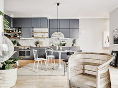 Gray kitchen with white dining space