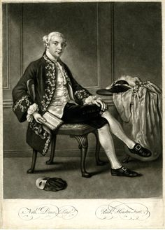 Portrait of Julines Beckford, whole-length seated, left hand resting on right knee, crossed over the other, holding a book in right hand with the elbow hooked over the back of his chair, looking towards the viewer, wearing dark coat with brocaded trim, wig with a queue, a masquerade domino and feathered hat on a table behind to right, a mask on the floor to left; after Dance. Mezzotint.