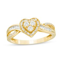 1/3 CT. T.W. Baguette and Round Trio Diamond Heart Frame Crossover Split Shank Ring in 10K Gold