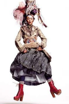 "Right, because I wear stuff like this to work every day.    ""Nomadas"", magnificent editorial under the sign of tribal elegance, successfully overlapping to pop suggestions, made for Vogue Spain January issue by the photographer Thomas Schenk and stylist Havana Lafitte, featuring the charming model Liu Wen and including smashing creations by John Galliano, Rodarte and Missoni."