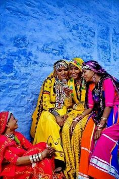 Colorful Indian ladies chatting on a cell phone.