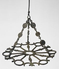 Polycandelon with Crosses Date: century Culture: Byzantine Medium: Copper alloy Dimensions: Ht. with chain 14 in. of plate: 10 Interior Design History, High Middle Ages, Candle Lamp, Candles, Medieval Life, Byzantine Art, Grand Palais, Glass Vessel, Art Object