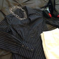 Express stretch button down Black & silver pinstriped stretch button down. V neckline for an elegant look. Stretch material perfect for everyday work wear. Rounded hemline for the perfect look untucked. Express Tops Button Down Shirts