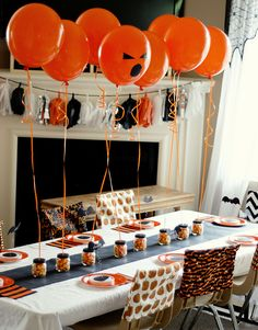 Halloween party table. I find the balloons the best part and definitely what I'm taking away from this photo. kinda hard to find helium but hey , where theres a will, theres a way.