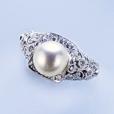antique kinda pearl engagement ring--reallllly love this as an alternative to the super cliche diamond ring.