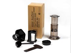 This is the AeroPress® Coffee Maker that we know and love. It's a complete coffee making system, including 350 AeroPress paper filters. We ship the AeroPress in this convenient cardboard package, as provided by the manufacturer, Aerobie, Inc. Its contents are exactly the same as the distinctive white six-sided retail box you may have seen.