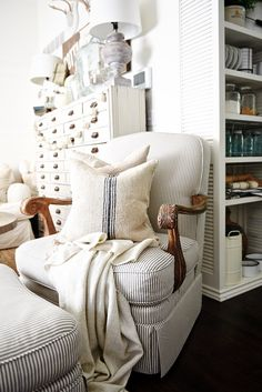 Cozy Neutral cottage style living room - Chair makeover with blue ticking fabric found at Joanns craft store.