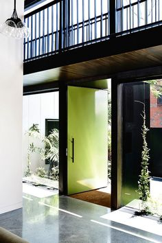 The fresh modern design of this inner-city Melbourne home is just stunning . formally a pub, it has been renovated perfectly … love the artwork by Carla Fletcher. Interior Architecture, Interior And Exterior, Interior Design, Porches, Bright Front Doors, Hill Interiors, Melbourne House, House Entrance, Mid Century House