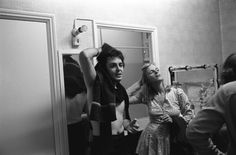 Paul and Linda McCartney in their dressing room after their performance in Bristol, England, during their band Wings' tour 1975.