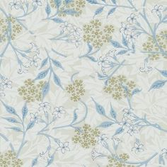 Jasmine Wallpaper 'Jasmine', designed in 1872 by William Morris, features a pattern of hawthorn leaves with blossoms and a meandering jasmine trail over the top in ecu and woad.