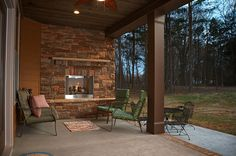 A beautiful outdoor fireplace in The Lisenby, plan 1220! http://www.dongardner.com/plan_details.aspx?pid=3522. #Outdoor #Fireplace #Design