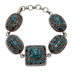 Handcrafted in India by skilled artisans, this bracelet features beautiful mosaic accents with firoja stones. This bracelet is finished with a convenient hook clasp.