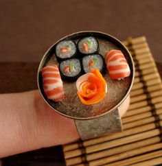 Cute, creative sushi ring! This is one of my fave artists. Check out her Etsy shop and DeviantArt page!